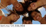 Купить «Young friends forming huddle at beach 4k», видеоролик № 31936954, снято 9 января 2019 г. (c) Wavebreak Media / Фотобанк Лори