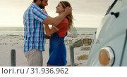 Купить «Couple embracing each other near camper van 4k», видеоролик № 31936962, снято 9 января 2019 г. (c) Wavebreak Media / Фотобанк Лори