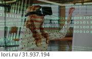 Купить «Woman wearing a virtual reality headset with binary codes», видеоролик № 31937194, снято 25 апреля 2019 г. (c) Wavebreak Media / Фотобанк Лори