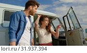 Купить «Young couple standing near camper van 4k», видеоролик № 31937394, снято 9 января 2019 г. (c) Wavebreak Media / Фотобанк Лори