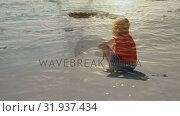 Купить «Woman sitting on sand», видеоролик № 31937434, снято 17 апреля 2019 г. (c) Wavebreak Media / Фотобанк Лори
