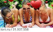 Купить «Female friends smiling 4k», видеоролик № 31937558, снято 25 апреля 2019 г. (c) Wavebreak Media / Фотобанк Лори