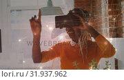 Купить «African-american woman wearing a virtual reality headset», видеоролик № 31937962, снято 25 апреля 2019 г. (c) Wavebreak Media / Фотобанк Лори