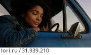 Купить «Woman leaning on window of pickup truck at beach 4k», видеоролик № 31939210, снято 8 февраля 2019 г. (c) Wavebreak Media / Фотобанк Лори