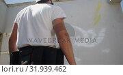 Купить «Graffiti artist standing with aerosol can 4k», видеоролик № 31939462, снято 4 февраля 2019 г. (c) Wavebreak Media / Фотобанк Лори