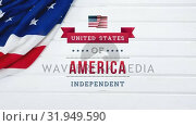 Купить «United States of America, Independent text in banner with flag», видеоролик № 31949590, снято 24 мая 2019 г. (c) Wavebreak Media / Фотобанк Лори