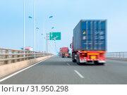 Купить «Container trucks motion blur on bay bridge , modern logistics concept», фото № 31950298, снято 10 апреля 2020 г. (c) easy Fotostock / Фотобанк Лори