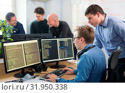 Купить «Startup business and entrepreneurship. Young software developers team brainstorming and programming on desktop computer in startup company share office space.», фото № 31950338, снято 4 апреля 2020 г. (c) easy Fotostock / Фотобанк Лори