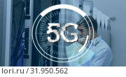 Купить «Man checking a server and 5G written in the middle of a futuristic circles 4k», видеоролик № 31950562, снято 8 мая 2019 г. (c) Wavebreak Media / Фотобанк Лори