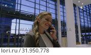 Купить «Businesswoman talking on mobile phone in the lobby at office 4k», видеоролик № 31950778, снято 21 марта 2019 г. (c) Wavebreak Media / Фотобанк Лори