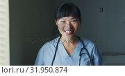 Купить «Young female doctor smiling to camera 4k», видеоролик № 31950874, снято 10 марта 2019 г. (c) Wavebreak Media / Фотобанк Лори