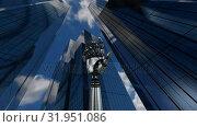 Robot hand rotating on bellow tall building. Стоковое видео, агентство Wavebreak Media / Фотобанк Лори