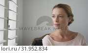 Купить «Woman looking outside through window at comfortable home 4k», видеоролик № 31952834, снято 12 марта 2019 г. (c) Wavebreak Media / Фотобанк Лори