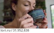 Купить «Woman drinking coffee in kitchen at comfortable home 4k», видеоролик № 31952838, снято 12 марта 2019 г. (c) Wavebreak Media / Фотобанк Лори