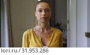 Купить «Woman looking at camera in a comfortable home 4k», видеоролик № 31953286, снято 12 марта 2019 г. (c) Wavebreak Media / Фотобанк Лори