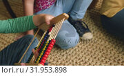 Купить «Boy learning mathematics on abacus at home 4k», видеоролик № 31953898, снято 12 марта 2019 г. (c) Wavebreak Media / Фотобанк Лори
