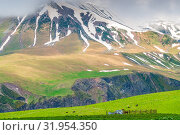 Купить «The slope of the Caucasus Mountains with the remnants of snow in June, the picturesque mountain landscape of Georgia», фото № 31954350, снято 3 июня 2018 г. (c) Константин Лабунский / Фотобанк Лори