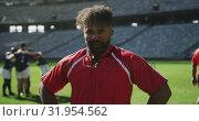 Купить «Male rugby player standing with hands on hip in stadium 4k», видеоролик № 31954562, снято 9 мая 2019 г. (c) Wavebreak Media / Фотобанк Лори