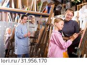 Купить «Female teacher helping girl during painting class», фото № 31956170, снято 21 августа 2019 г. (c) Яков Филимонов / Фотобанк Лори