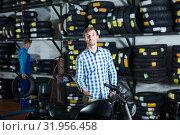Купить «Young man customer holding his motorcycle», фото № 31956458, снято 24 августа 2019 г. (c) Яков Филимонов / Фотобанк Лори