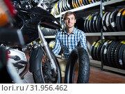 Купить «Glad man customer holding his motorcycle», фото № 31956462, снято 24 августа 2019 г. (c) Яков Филимонов / Фотобанк Лори