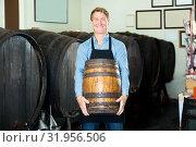 Купить «Man carrying wine wood in hands», фото № 31956506, снято 6 июня 2020 г. (c) Яков Филимонов / Фотобанк Лори
