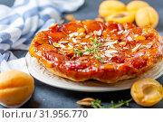 Купить «Apricot and almond tarte tatin on a white plate», фото № 31956770, снято 10 июля 2019 г. (c) Марина Сапрунова / Фотобанк Лори