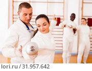 Купить «Woman practicing new movements with trainer at fencing room», фото № 31957642, снято 11 июля 2018 г. (c) Яков Филимонов / Фотобанк Лори