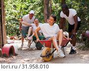 Купить «Group of people at adventure park», фото № 31958010, снято 18 сентября 2019 г. (c) Яков Филимонов / Фотобанк Лори