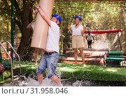 Купить «People passing obstacle at adventure park», фото № 31958046, снято 21 сентября 2019 г. (c) Яков Филимонов / Фотобанк Лори