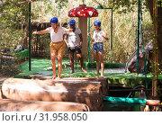 Купить «Two teams compete on an obstacle course in an amusement park.», фото № 31958050, снято 25 августа 2019 г. (c) Яков Филимонов / Фотобанк Лори