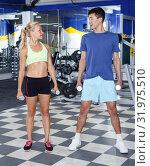 Купить «Couple during weightlifting workout», фото № 31975510, снято 16 июля 2018 г. (c) Яков Филимонов / Фотобанк Лори