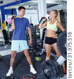 Купить «Couple during weightlifting workout», фото № 31975518, снято 16 июля 2018 г. (c) Яков Филимонов / Фотобанк Лори