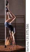 Купить «Young woman in denim shorts practicing pole dancing», фото № 31975586, снято 9 декабря 2019 г. (c) Яков Филимонов / Фотобанк Лори