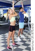 couple during common weightlifting workout. Стоковое фото, фотограф Яков Филимонов / Фотобанк Лори