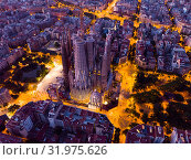 Купить «Barcelona, Spain - June 13, 2019: View from dorne of the famous Spanish landmark - temple Sagrada familia», фото № 31975626, снято 13 июня 2019 г. (c) Яков Филимонов / Фотобанк Лори