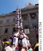 Купить «Castellers make castell near ayuntamiento building during La Merca in Barcelona», фото № 31975794, снято 23 сентября 2018 г. (c) Яков Филимонов / Фотобанк Лори