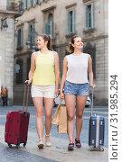 Купить «female tourists exploring old european city with baggage», фото № 31985294, снято 29 мая 2017 г. (c) Яков Филимонов / Фотобанк Лори