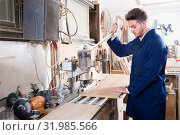 Купить «Man practising his skills with milling cutter at workplace», фото № 31985566, снято 7 ноября 2016 г. (c) Яков Филимонов / Фотобанк Лори