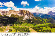 Aerial top view from drone to Col Raiser plateau In sunny summer Day. Scenery of rugged Sella Mountain with green valley on grassy hillside village St. Cristina di Val Gardena, Bolzano, Seceda Italy. Стоковое фото, фотограф Алексей Ширманов / Фотобанк Лори