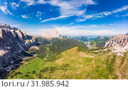 Dolomites - Beautiful panoramic sunset landscape at Gardena Pass, Passo Giau, near Ortisei. Stunning airial view on the top Dolomiti Alps Mountains from drone on summer day, Italy, south Tyrol Europe. Редакционное фото, фотограф Алексей Ширманов / Фотобанк Лори