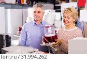 Купить «Man and woman 47-57 years old are buying in shop of household ap», фото № 31994262, снято 22 августа 2019 г. (c) Яков Филимонов / Фотобанк Лори
