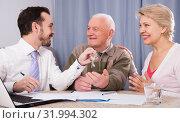Купить «Old man and woman sign rent agreement», фото № 31994302, снято 20 ноября 2019 г. (c) Яков Филимонов / Фотобанк Лори