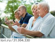 Купить «mature smiling people chatting in phones», фото № 31994330, снято 24 августа 2017 г. (c) Яков Филимонов / Фотобанк Лори