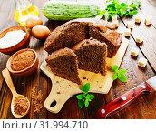 Купить «Zucchini cake with cocoa powder», фото № 31994710, снято 3 июля 2019 г. (c) Надежда Мишкова / Фотобанк Лори