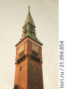 Купить «Clock tower of Copenhagen city hall», фото № 31994854, снято 9 декабря 2017 г. (c) EugeneSergeev / Фотобанк Лори