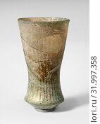 Купить «Glass bell beaker, Medieval, 6th–7th century A.D., Frankish, Glass, blown using a dip mold and trailed, H.: 4 1/2 in. (11.4 cm), Glass, Translucent blue...», фото № 31997358, снято 15 мая 2017 г. (c) age Fotostock / Фотобанк Лори