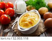 Купить «Potato casserole», фото № 32003118, снято 17 июня 2019 г. (c) Надежда Мишкова / Фотобанк Лори