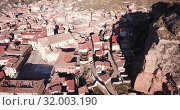 Купить «Aerial view of tiled roofs and old streets of Daroca, Spain», видеоролик № 32003190, снято 10 марта 2019 г. (c) Яков Филимонов / Фотобанк Лори