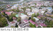 Купить «Aerial panoramic view of modern cityscape of Russian town of Kaluga overlooking black domes of Holy Trinity Cathedral», видеоролик № 32003418, снято 2 мая 2019 г. (c) Яков Филимонов / Фотобанк Лори